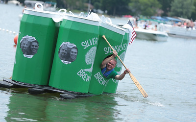 "Michelle LaVigne/ For Shaw Media Mat Chambers helps make the turn  during the 32nd annual America's Cardboard Cup Regatta June 18 at the Crystal Lake Park District's Main Beach. Cary neighbors Joe Riegle and Chambers named their boat Silvertree for the street they both live on. ""One of these days we plan to actually brew beer together,"" Riegle said."