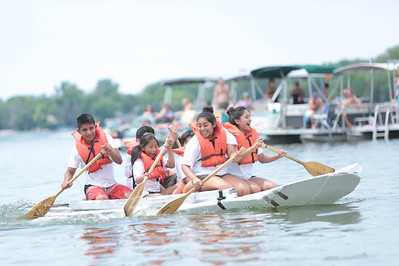 Michelle LaVigne/ For Shaw Media Starting front, furthest right to left, While 14-year-old Jacqui Hernandez and 14-year-old Daniela Diaz lead their crew, 10-year-old Valeria Diaz and 17-year-old Eduardo Diaz, all of Crystal Lake, paddle their way to the finish line during the 32nd annual America's Cardboard Cup Regatta June 18 at the Crystal Lake Park District's Main Beach.