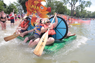 """Michelle LaVigne/ For Shaw Media Heather Killian of Northbrook, 10-year-old Kane Swisher of Crystal Lake and Kelly Wilson of Des Plaines take off at the start of the 32nd annual America's Cardboard Cup Regatta June 18 at the Crystal Lake Park District's Main Beach. Killian has competed for 16 years in the regatta although this is first year she participated without her children. """"My kids asked me 'why are you doing this?' and I told them, 'hey I have to live!'"""""""