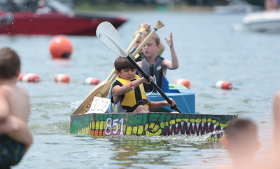 Michelle LaVigne/ For Shaw Media Eight-year-old Logan Voss of Wonder Lake takes the lead to finish first in the children division during the 32nd annual America's Cardboard Cup Regatta June 18 at the Crystal Lake Park District's Main Beach.