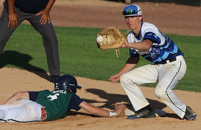 Sarah Nader - snader@shawmedia.com New Trier's Liam O'Neill (left) safely slide back to first while St. Charles North's Luke Corcoran reaches for the ball during the sixth inning of Monday's Class 4A Boomers Stadium Supersectional at Boomers Stadium in Schaumburg June 5, 2016. St. Charles North defeated New Trier, 4-3.