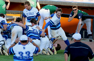 Sarah Nader - snader@shawmedia.com The St. Charles North baseball team celebrates after winning Monday's Class 4A Boomers Stadium Supersectional against New Trier at Boomers Stadium June 5, 2016. St. Charles North defeated New Trier, 4-3.