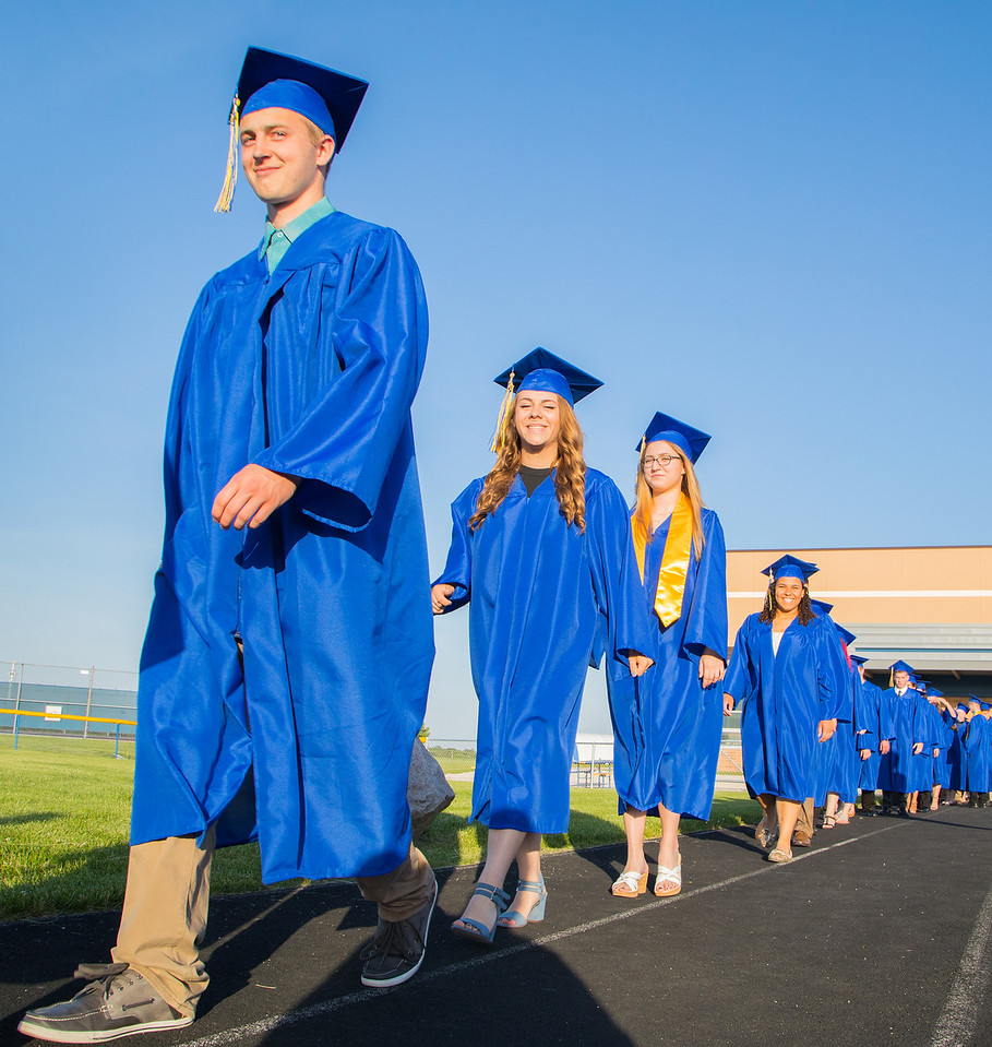 The class of 2017 takes the field for the commencement ceremony Friday, Jun 2, 2017 at Johnsburg High School in Johnsburg.  KKoontz – For Shaw Media