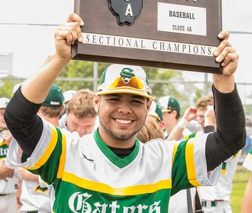 Crystal Lake South's Brian Fuentes Reyes holds up the Class 4A sectional Championship trophy Saturday, Jun 3, 2017 at Peterson Park in McHenry. Crystal Lake South brought home the victory over Huntley 6-2. KKoontz- For Shaw Media