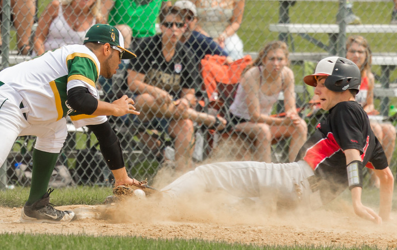 Huntley outfielder Joey Petryniec slides just under the tag of Crystal Lake South third-baseman Brian Fuentes Reyes Saturday, Jun 3, 2017 at Peterson Park in McHenry. Crystal Lake South went on to win the Class 4A sectional championship game 6-2. KKoontz – For Shaw Media