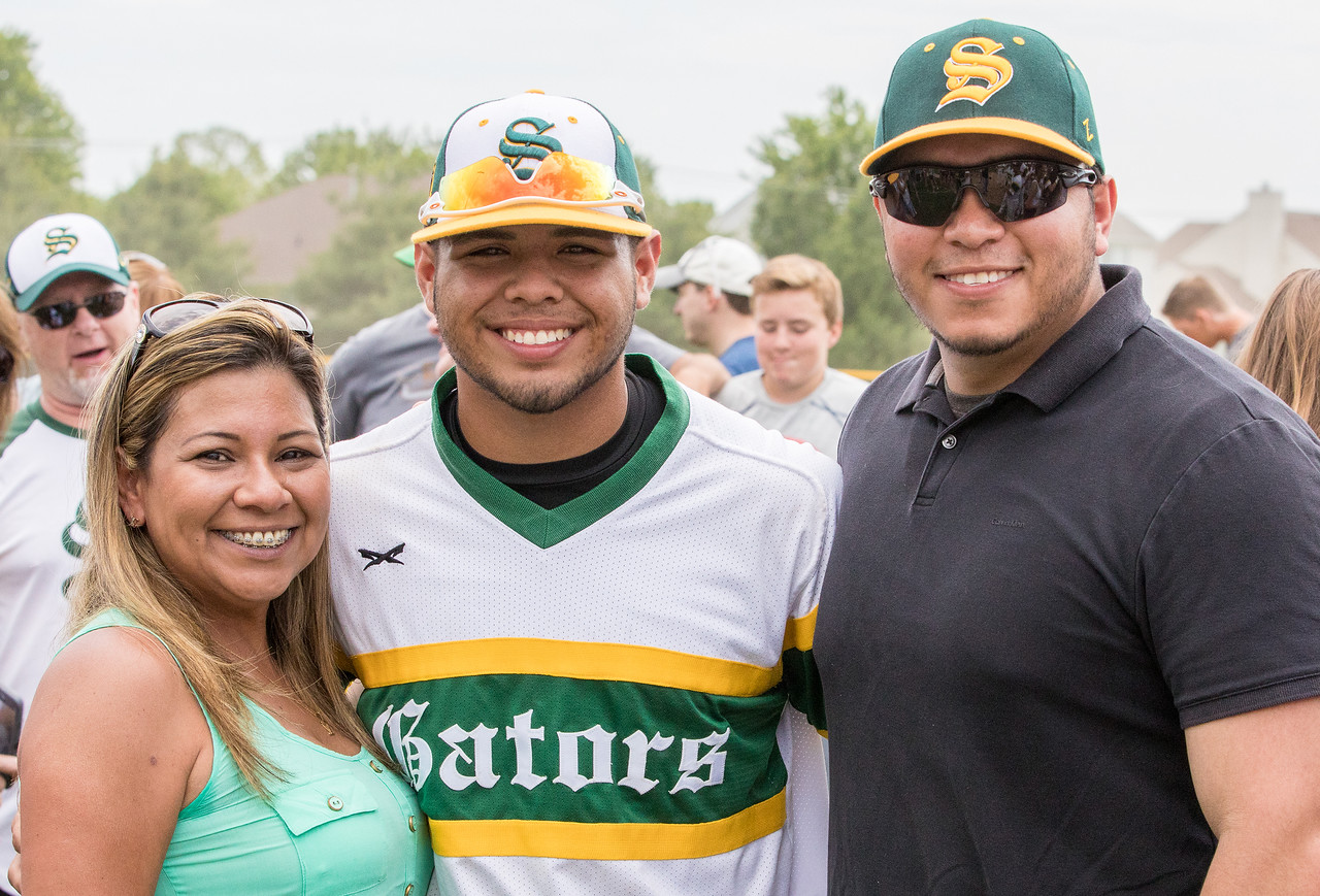 Scarlett, Brian and Damil Fuentes (L-R) pose for a photo Saturday, Jun 3, 2017 at Peterson Park in McHenry. Crystal Lake South went on to win the Class 4A sectional championship game 6-2. KKoontz – For Shaw Media