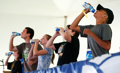Juan Ortega, 13 from Harvard, wins the 11-13 year-old division of Harvard's Milk Days annual milk chugging contest on Saturday, June 3, 2017 in Harvard. John Konstantaras photo for the Northwest Herald