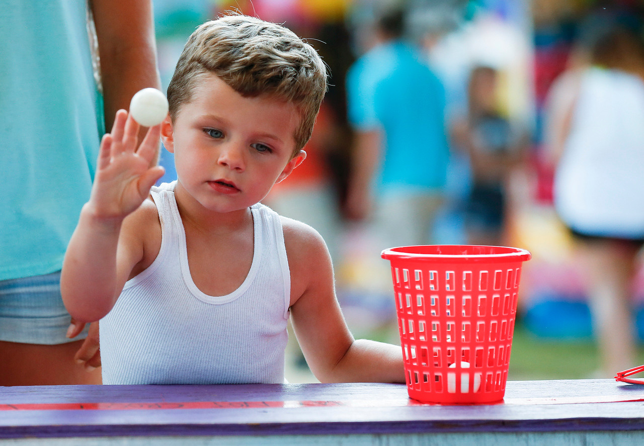 Blake Vermett, 3 from Harvard tosses a ball as he tries to win a prize at Harvard's Milk Days on Saturday, June 3, 2017 in Harvard. John Konstantaras photo for the Northwest Herald