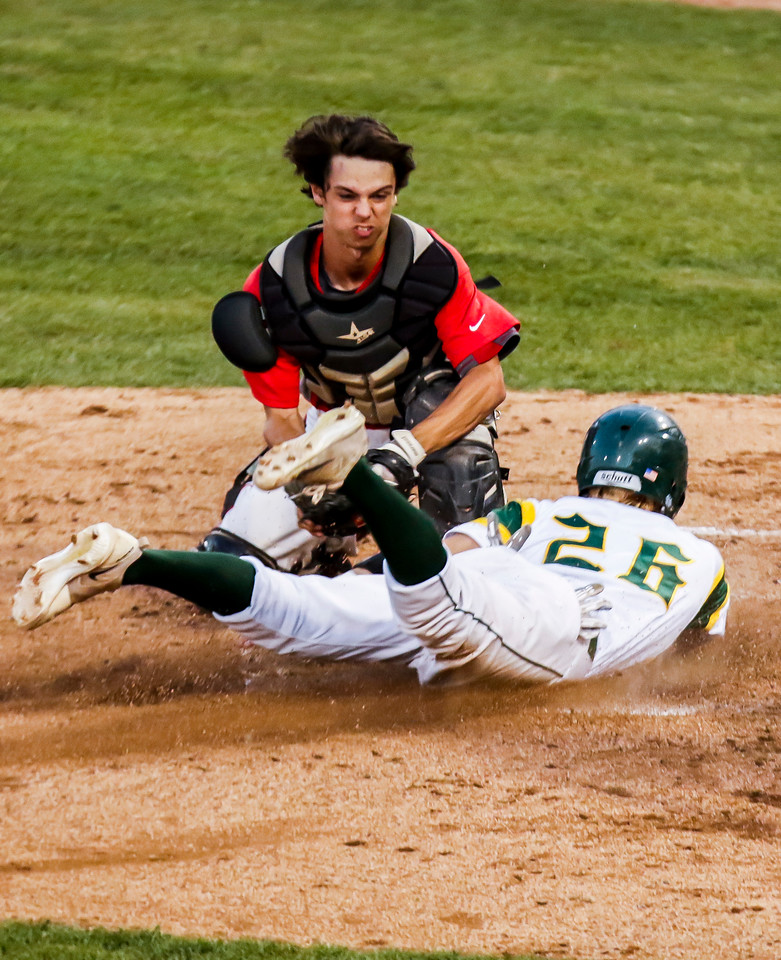 Sarah Nader - snader@shawmedia.com Mundelein's Mason Schaller (left) tags out Crystal Lake South's Ryan Parquette while he slides home during the first inning of Monday's Class 4A Super Sectional sectional championship game June 5, 2017 at Boomers Stadium in Schaumburg . South won, 6-2.