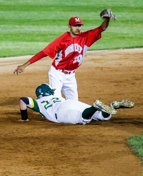 Sarah Nader - snader@shawmedia.com Crystal Lake South's Michael Swiatly is out by Mundelein's Ryan Patel while he slides back to second during the fourth inning of Monday's Class 4A Super Sectional sectional championship game June 5, 2017 at Boomers Stadium in Schaumburg . South won, 6-2.