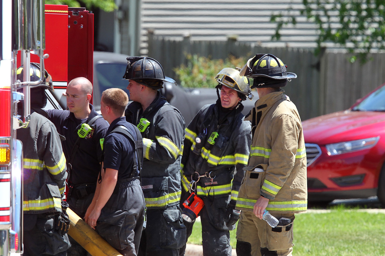 H. Rick Bamman - hbamman@shawmedia.com Firefighters investigate a fire Monday, June 5, 2917 in a garage at 123 Norman Drive in McHenry.