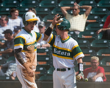 Paul Bergstrom for Shaw Media Crystal Lake South's Brent Chubb (15) high fives Griffin Bright (5) after stealing three bases for a run during the 4A State Semi-Final game against New Trier hosted at Silver Cross Field in Joliet.