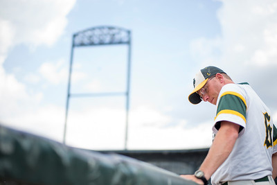 Paul Bergstrom for Shaw Media Crystal Lake South Head Coach Brian Bogda watches the game from the dugout during the 4A State Semi-Final game against New Trier hosted at Silver Cross Field in Joliet.