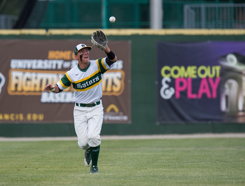 Paul Bergstrom for Shaw Media Cristal Lake South's Michael Swiatly (22) catches a fly ball during the 4A State Semi-Final game against New Trier hosted at Silver Cross Field in Joliet.