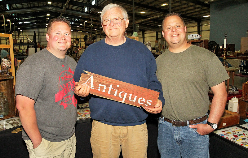 Candace H. Johnson-For Shaw Media Bob Zurko, owner of Zurko Promotions, (center) with his sons Adam and Tim at the Grayslake Antique & Vintage Market at the Lake County Fairgrounds in Grayslake. The Zurko family has put on the Grayslake Antique & Vintage Market since 2001.