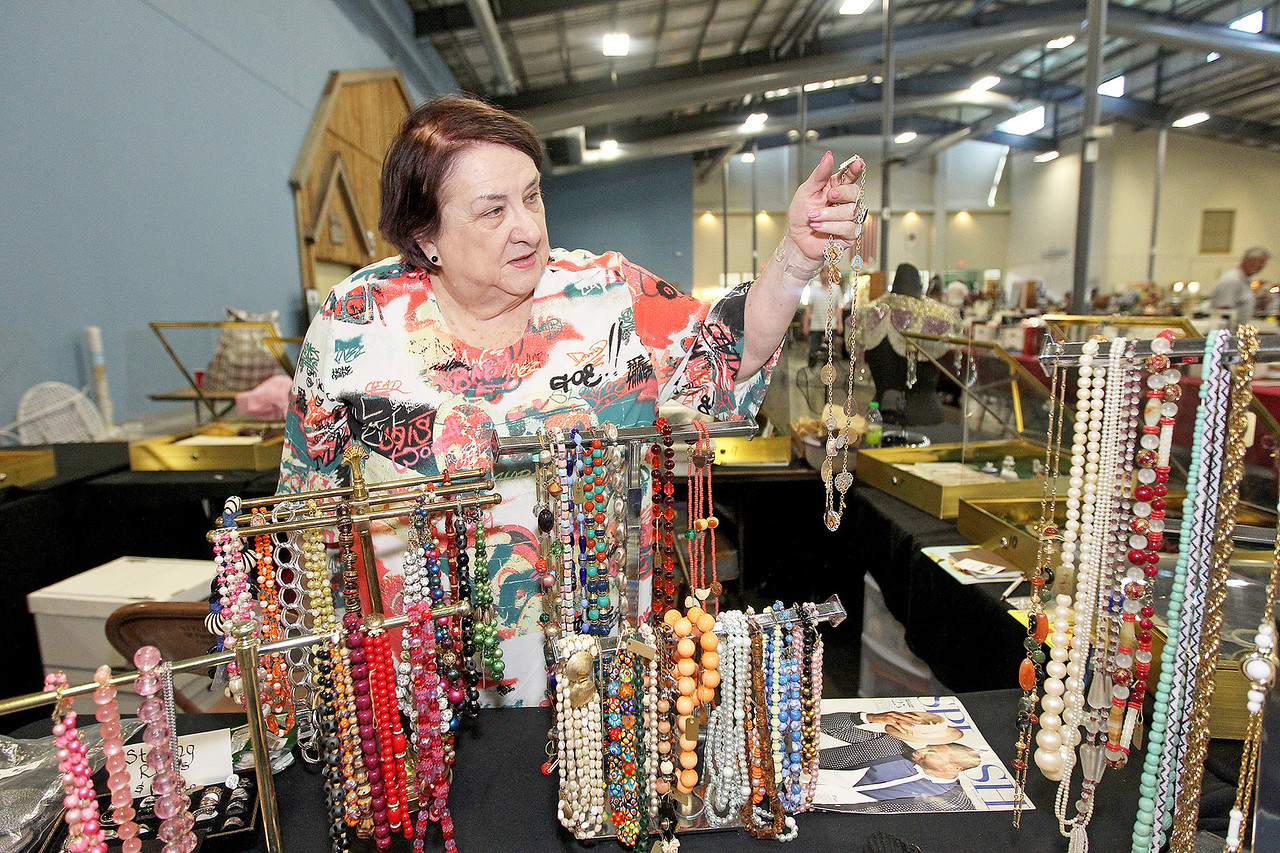 Candace H. Johnson-For Shaw Media Ellen Germanos, of Arlington Heights shows a necklace with medals on it she had in her collection at the Grayslake Antique & Vintage Market at the Lake County Fairgrounds in Grayslake.