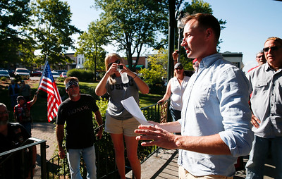 Marine Recon Sergeant Jared Fringer, a 2007 Woodstock HS alum, talks to a small crowd gathered on the Woodstock Square for a welcome home ceremony honoring the local hero on Friday, June 16, 2017 in Woodstock, Illinois. John Konstantaras photo for the Northwest Herald