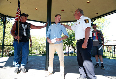 Marine Recon Sergeant Jared Fringer, a 2007 Woodstock HS alum, is greeted by McHenry County Sheriff Bill Prim, right, and Warriors' Watch Rider Joe Alger, left, during a welcome home ceremony at the Woodstock Square gazebo honoring the local hero on Friday, June 16, 2017 in Woodstock, Illinois. John Konstantaras photo for the Northwest Herald