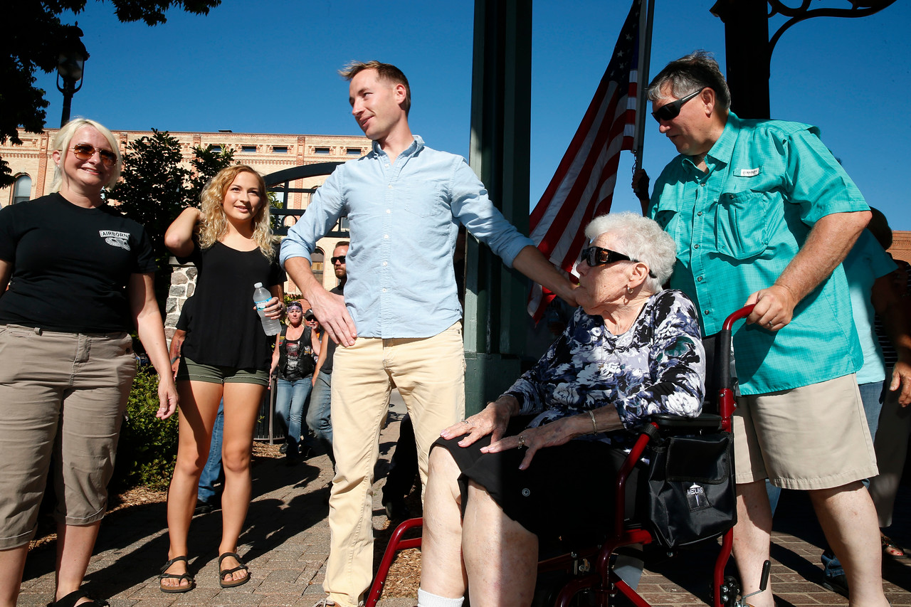 Marine Recon Sergeant Jared Fringer, a 2007 Woodstock HS alum, stands with his grandmother Vicki, 92 right, mom De, left, and sister Haley, 16 center, as he was surprised with a welcome home ceremony on the Woodstock Square honoring the local hero on Friday, June 16, 2017 in Woodstock, Illinois. John Konstantaras photo for the Northwest Herald