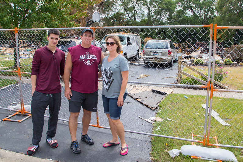 Austin, Tim and Kim Keefer (L-R) stand in front of what is left of their home in Marengo Saturday, June 17, 2017. Tim Keefer is the wrestling coach at Marengo, and the wrestling community is organizing a benefit for the Keefer family Sunday, June 25, 2017. The home was destroyed in the gas explosion last Sunday morning. Ken Koontz- For Shaw Media