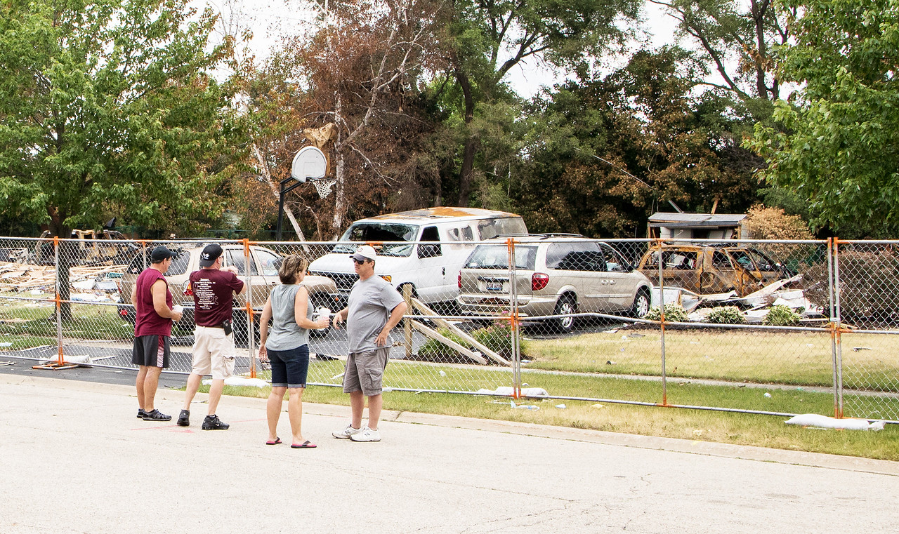 Tim (far left) and Kim (3rd from left) Keefer talk with neighbors in front of their home in Marengo Saturday, June 17, 2017 after it was destroyed by a gas explosion last Sunday morning. Tim Keefer is the wrestling coach at Marengo, and the wrestling community is organizing a benefit for the Keefer family Sunday, June 25, 2017. Ken Koontz- For Shaw Media