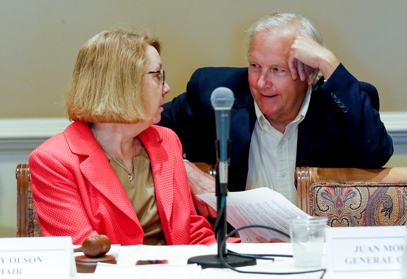 Sarah Nader - snader@shawmedia.com Kathy Olson (left), chairman of the Illinois Health Facilities and Services Review Board talks with board member senator Brad Burzynski before a Health Facilities and Service Review Board hearing for the Mercy hospital that plans to build in Crystal Lake Tuesday, June 20, 2017 in Bolingbrook. There were presentations of support and opposition while the board members determined how to decide on this $80 million facility.