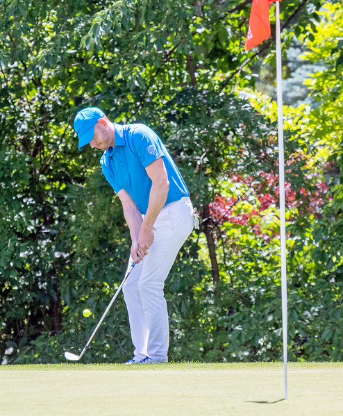 Crystal Lake Central grad Greg Bauman chips onto the green Saturday June 24, 2017, during the McHenry County Amateur Golf Tournament held at the McHenry Country Club in McHenry. Tied with Steve Sawtell, Bauman won in a playoff with eagle from about 40 yards. KKoontz- for Shaw Media