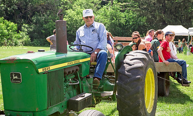 "Mike Greene - For Shaw Media  Vern Schiller takes a group of attendees out for a hayride during the 10th annual ""A Day at Petersen Farm"" Sunday, June 25, 2017 in McHenry. This year's event featured hayrides, farm animals, music and children's games as well as exhibits showing McHenry County farm life in 1916."