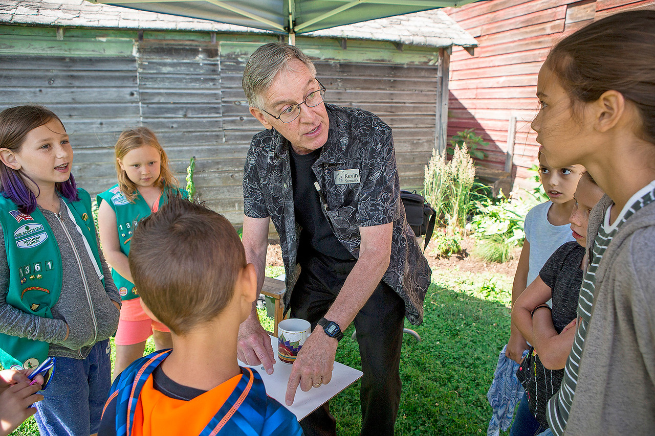 "Mike Greene - For Shaw Media  Kevin Sarnwick entertains a group of children during the 10th annual ""A Day at Petersen Farm"" Sunday, June 25, 2017 in McHenry. This year's event featured hayrides, farm animals, music and children's games as well as exhibits showing McHenry County farm life in 1916."