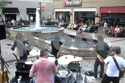 A crowd listens to the band Rocks Off June 21, during the Block to Block Party in Fountain Plaza at Elmhurst City Centre. There is live music in the City Centre Plaza and the new plaza at 255 N. York St every Wednesday night in June and July. Mark Busch - mbusch@shawmedia.com