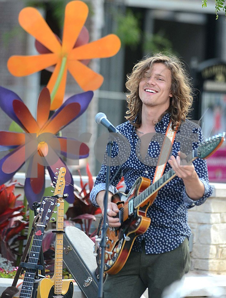Guitar player Trevor Pritchett of the band Rocks Off smiles while playing June 21, during the Block to Block Party in Fountain Plaza at Elmhurst City Centre. There is live music in the City Centre Plaza and the new plaza at 255 N. York St every Wednesday night in June and July. Mark Busch - mbusch@shawmedia.com