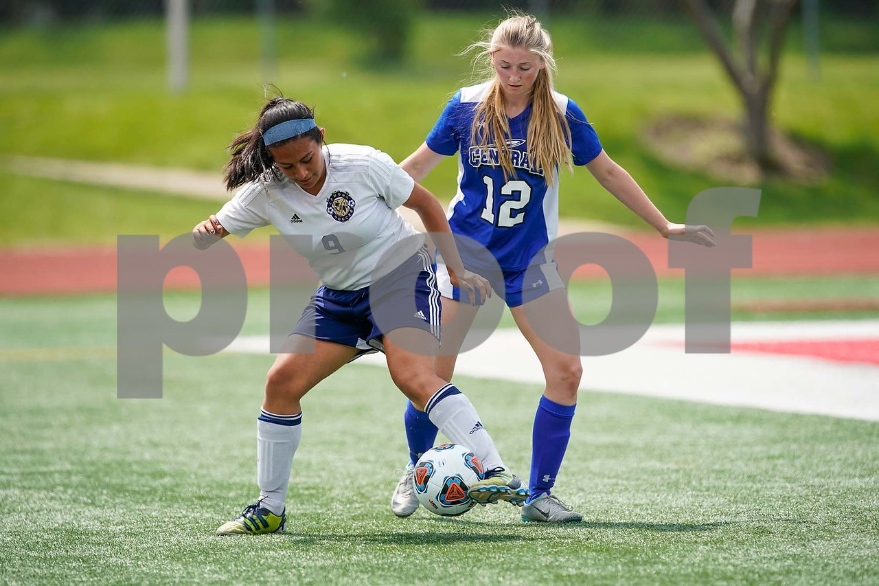 Lemont forward Adriana Patino (9) plays the ball against Burlington Central's defender Taylor Abbott (12) during a Class 2A third place state final at North Central College in Naperville June 3. Sean King for Shaw Media