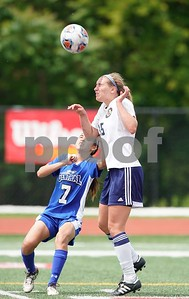Lemont defender Sarah Knoepfle (15) goes up for a header against Burlington Central's midfielder Kyrsten Pellikan (7) during a Class 2A third place state final at North Central College in Naperville June 3. Sean King for Shaw Media