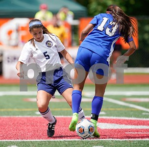 Lemont midfielder Jacqueline Aleman (5) challenges Burlington Central's defender Alexis Rosa (13) for the ball during a 2A third place state final at North Central College in Naperville June 3. Sean King for Shaw Media