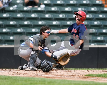 Willowbrook's Marshall McDonnell waits for the ball as a South Elgin runner scores during the Class 4A baseball sectional final June 3 at Boomers Stadium in Schaumburg. David Toney for Shaw Media