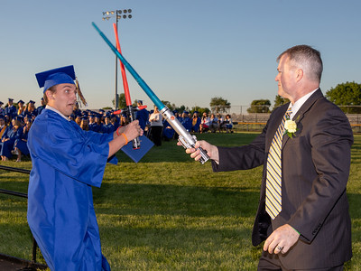 Nate Kirk (L) and Johnsburg High School Principal Kevin Sheldon have a light saber battle following the graduation ceremony Friday, June 1, 2018 in Johnsburg. KKoontz – For Shaw Media