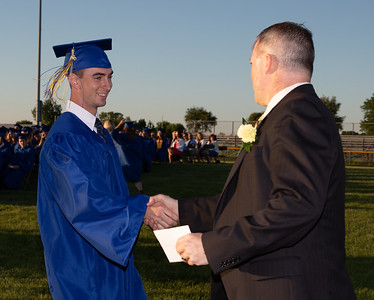 Adam Jayko (L) and Johnsburg High School Principal Kevin Sheldon shake hands following the graduation ceremony Friday, June 1, 2018 in Johnsburg. KKoontz – For Shaw Media