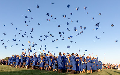 Caps go flying after the Johnsburg Class of 2018 is presented Friday, June 1, 2018 in Johnsburg. KKoontz – For Shaw Media