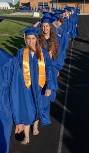 Brianne Ansell and Alex Arber, along with other graduating seniors make their way towards the graduation ceremony Friday, June 1, 2018 in Johnsburg. KKoontz – For Shaw Media