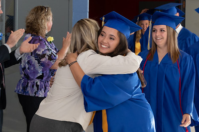Johnsburg graduating senior, Amber Humphres receives a hug from a teacher before the Johnsburg High School graduation ceremony Friday, June 1, 2018 in Johnsburg. KKoontz – For Shaw Media
