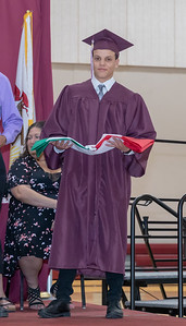 Foreign exchange student Giuseppe Mastrorocco from Italy exchanges country flags during the 2018 Marengo High School graduation ceremony Sunday, June 3, 2018 in Marengo. KKoontz – For Shaw Media