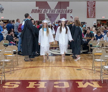 Payton Bachochin and Esther Garcia enter the gym for the 2018 Marengo High School graduation ceremony Sunday, June 3, 2018 in Marengo. KKoontz – For Shaw Media