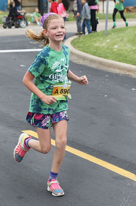 Candace H. Johnson-For Shaw Media Kaylie Socie, of Grayslake, a third grader from the Meadowview Elementary School in Grayslake, runs during the Squeez'd Girls on the Run North 5K at the College of Lake County in Grayslake.(6/2/18)