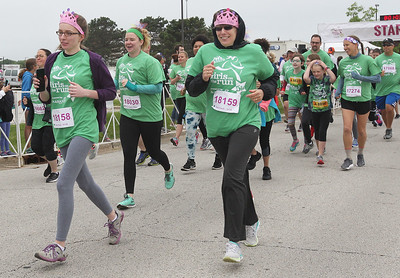 Candace H. Johnson-For Shaw Media Runners take off during the Squeez'd Girls on the Run North 5K at the College of Lake County in Grayslake.(6/2/18)