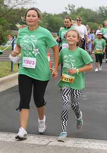 Candace H. Johnson-For Shaw Media Melinda Rozsas, of Wauconda and her daughter, Nora, 9, run together during the Squeez'd Girls on the Run North 5K at the College of Lake County in Grayslake.(6/2/18)