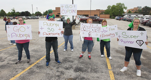Candace H. Johnson-For Shaw Media Family members and friends cheer on the students from the Stuart R. Paddock School in Palatine as they run in the Squeez'd Girls on the Run North 5K at the College of Lake County in Grayslake.(6/2/18)