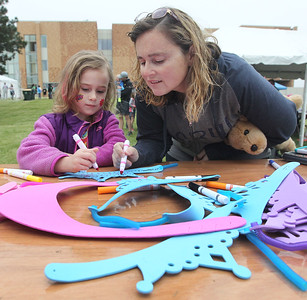 Candace H. Johnson-For Shaw Media Emily Swartz, 5, of Grayslake and her mother, Marsha, make a tiara craft while the Squeez'd Girls on the Run North 5K took place at the College of Lake County in Grayslake.(6/2/18)