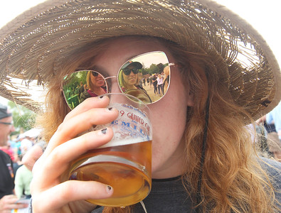 Candace H. Johnson-For Shaw Media Ashley Hahn, of Kenosha, Wis., drinks a sample of a Two Brothers IPA, with her friend, Lara Clarkson, of Gurnee (reflection in glasses) during the 6th Annual Grayslake Craft Beer Festival in downtown Grayslake.(6/2/18)