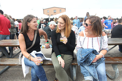 Candace H. Johnson-For Shaw Media Jenn Wurslin, of Vernon Hills, Amy Giel, of Glenview and Emily DeSousa, of Vernon Hills sit together to sample different beers during the 6th Annual Grayslake Craft Beer Festival in downtown Grayslake.(6/2/18)