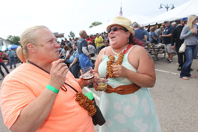 Candace H. Johnson-For Shaw Media Christine Duffy, of Sebree, Ky. shares a laugh with her daughter, Melysa Rice, of Grayslake during the 6th Annual Grayslake Craft Beer Festival in downtown Grayslake.(6/2/18)
